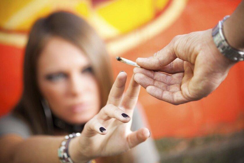 Passing a marijuana cigarette.