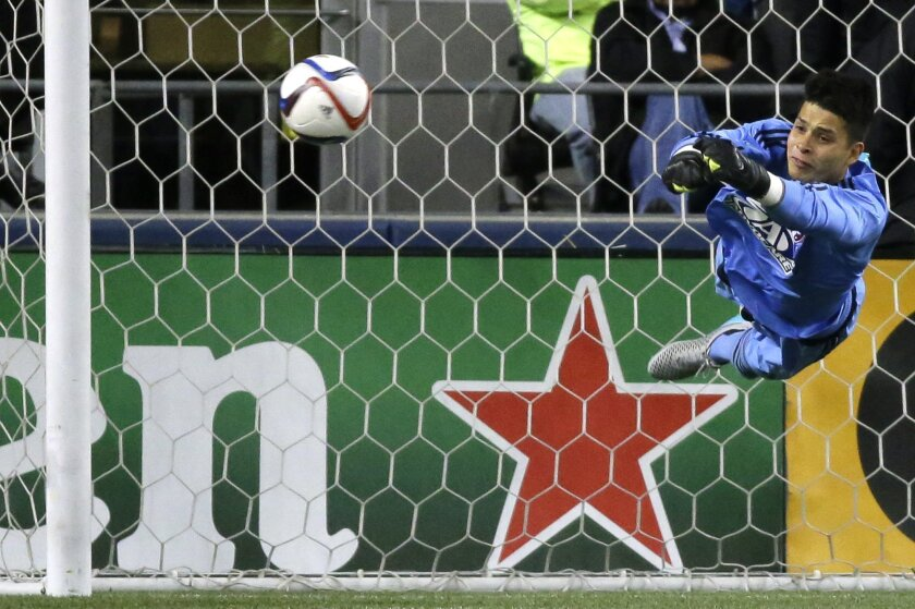 FC Dallas goalkeeper Jesse Gonzalez dives to make a save in the first half of an MLS soccer western conference semifinal playoff match against the Seattle Sounders, Sunday, Nov. 1, 2015, in Seattle. (AP Photo/Ted S. Warren)