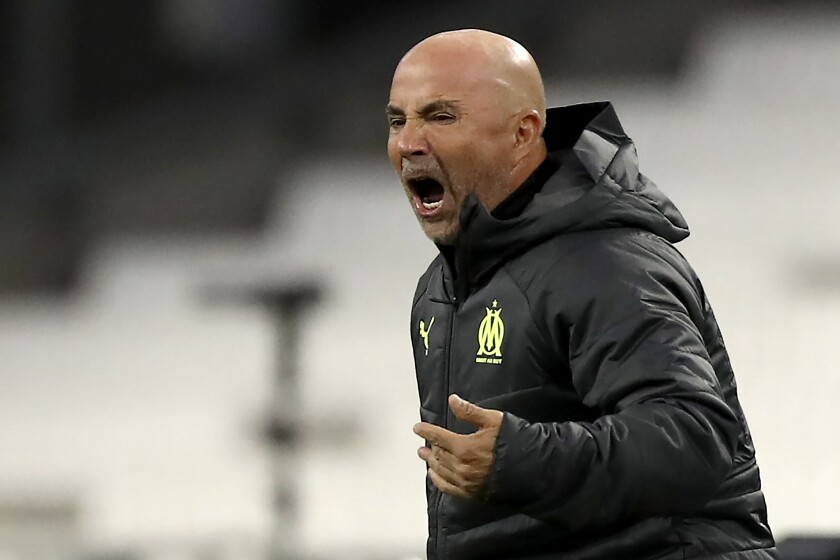 Marseille's new head coach Jorge Sampaoli gives instructions to his players during the French League One soccer match between Marseille and Rennes at the Stade Velodrome in Marseille, southern France, Wednesday March 10, 2021. (AP Photo/Daniel Cole)