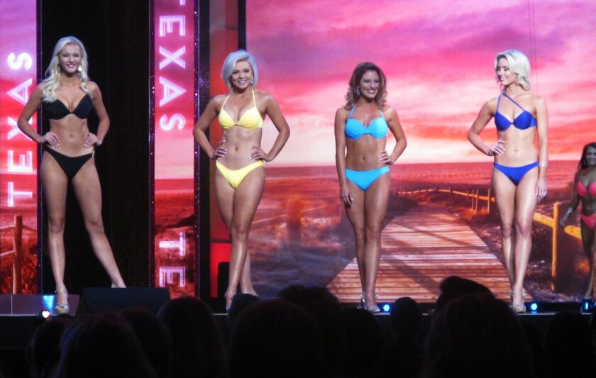 In this Sept. 8, 2015 photo, contestants pose in the swimsuit competition of the Miss America pageant in Atlantic City, N.J. On Tuesday Feb. 16, 2016, New Jersey approved a three-year $11.9 million deal with the Miss America Organization and Dick Clark Productions to keep the pageant in Atlantic Ci