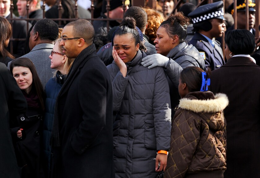 Mourners gather outside Chicago's Greater Harvest Baptist Church before the funeral for 15-year-old Hadiya Pendleton on Saturday.