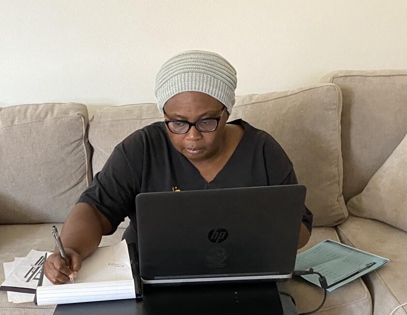 Sixth-grade teacher Aba Ngissah works from home