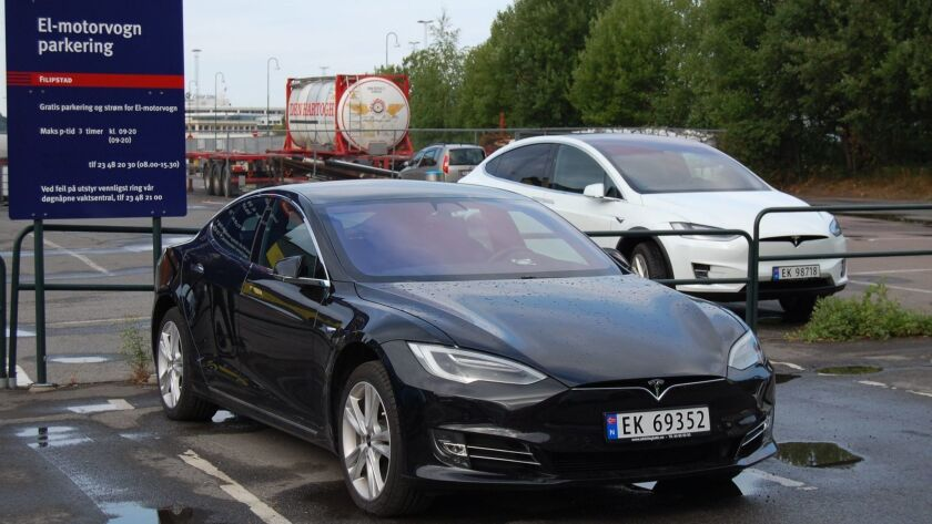 Tesla Model S and Model X electric vehicles parked in Oslo, Norway.