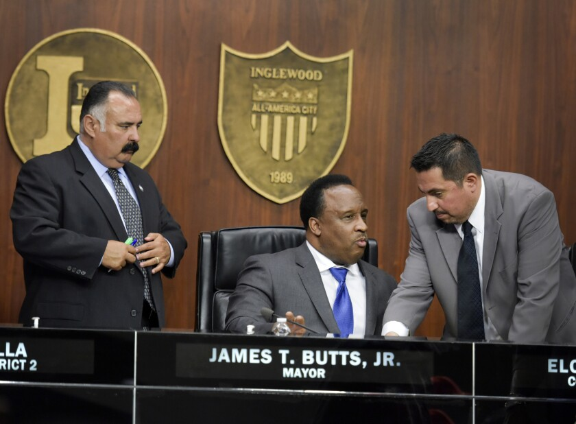 Councilman Alex Padilla, left, Mayor James Butts, center, and Councilman Eloy Morales, Jr. after an Inglewood City Council meeting in March.