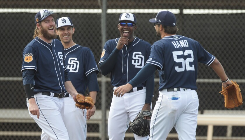 Padres pitchers, from left, Brandon Maurer, Christian Friedrich, Tyrell Jenkins and Brad Hand have fun during spring training at the Peoria Sports Complex in Peoria, Arizona, on Friday morning.