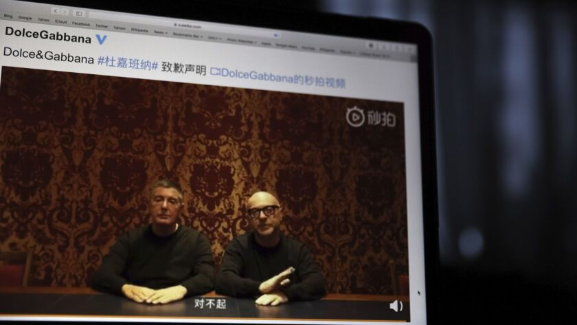 Founders of Dolce & Gabbana Domenico Dolce, left, and Stefano Gabbana apologize in a video.