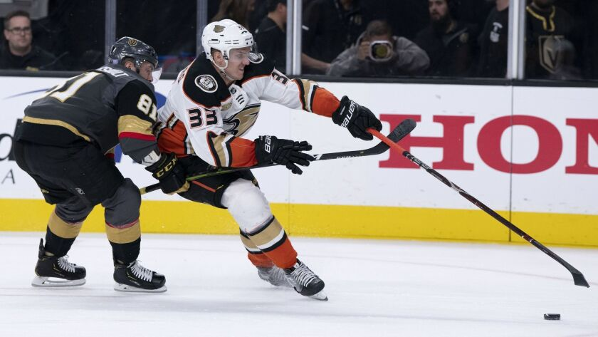 Ducks right wing Jakob Silfverberg (33) battles Vegas Golden Knights center Jonathan Marchessault for the puck during a game earlier this season.