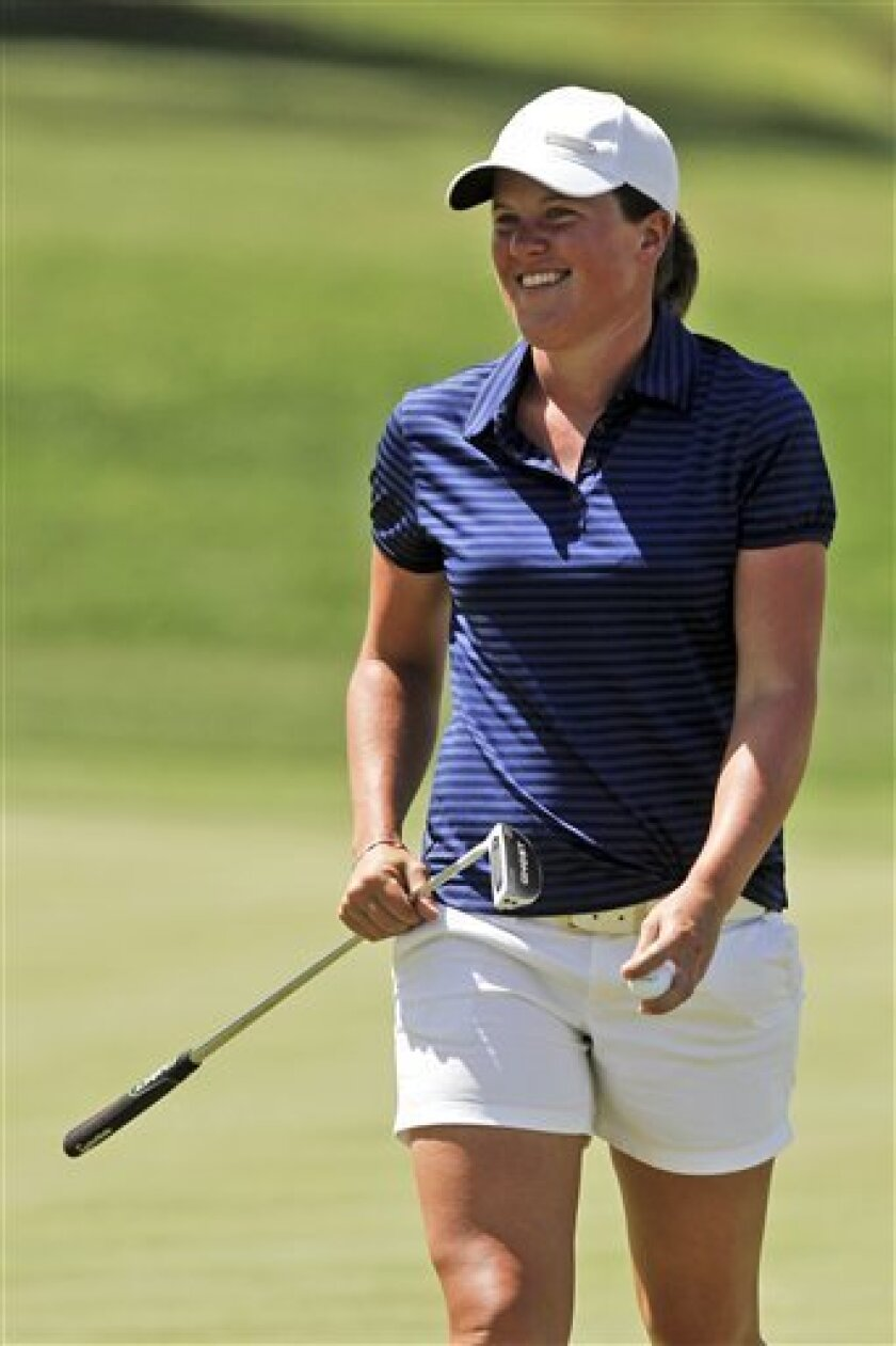 Karin Sjodin, of Sweden, smiles after a birdie on the fourth hole during the third round of the LPGA Kraft Nabisco Championship golf tournament in Rancho Mirage, Calif., Saturday, March 31, 2012. (AP Photo/Chris Carlson)