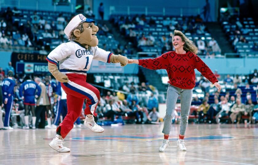 Sam Dunk dances with a fan