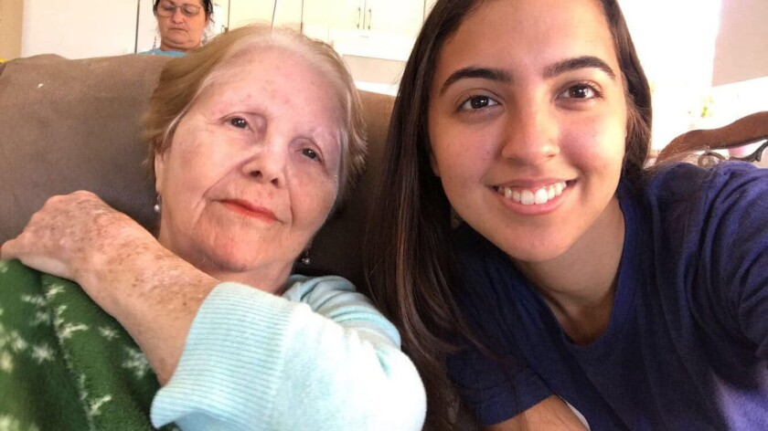 "Maria Piloto, 80, likes to ""dance"" in the car to Cuban music with Zuny Meza, 23, her Papa Pal."