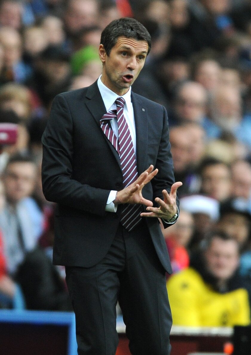 Aston Villa manager Remi Garde gives instructions to his players during the English Premier League soccer match between Aston Villa and Manchester City at the Villa Park, Birmingham, England, Sunday, Nov. 8, 2015. (AP Photo/Rui Vieira)