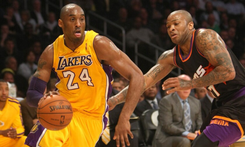 The Los Angeles Lakers' Kobe Bryant is pressured by the Phoenix Suns' Michael Beasley, left, Shannon Brown (6), and Markieff Morris.