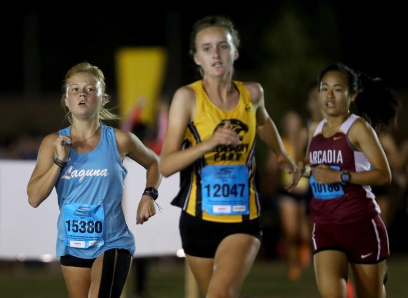 Laguna Beach High School cross country runner Hannah Konkel, left, ran in the sweepstakes individual