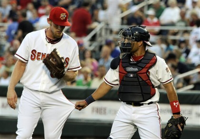 Washington Nationals pitcher Stephen Strasburg, left, confers with catcher Ivan Rodriguez, right, in the second inning against the Portland Sea Dogs during a rehab start with the minor league Harrisburg Senators, Thursday, Sept. 1, 2011, in Harrisburg, Pa. (AP Photo/Bradley C Bower)