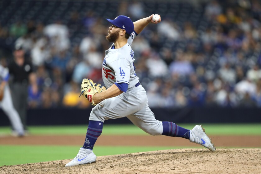 Russell Martin delivers a pitch in the ninth inning of the Dodgers' 9-0 victory over the Padres on Tuesday.