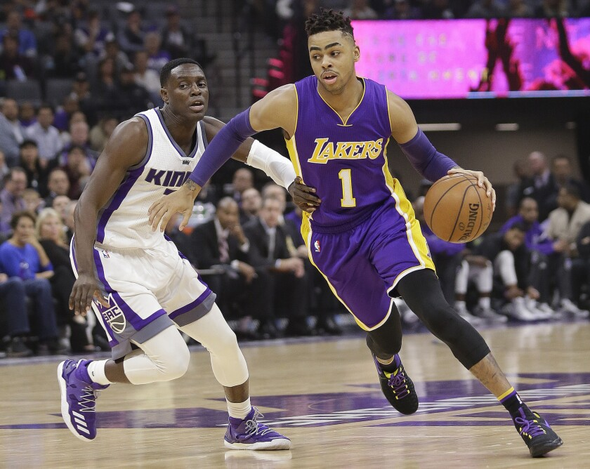 Lakers guard D'Angelo Russell (1) drives against Sacramento Kings guard Darren Collison during the first half on Dec. 12.