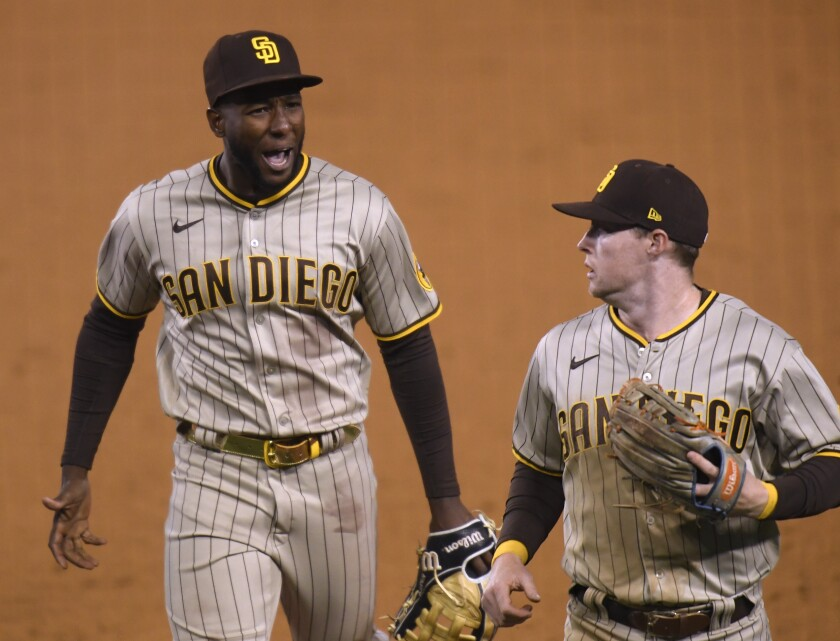 Jurickson Profar (left) and Jake Cronenworth of the Padres react after an inning-ending double play.