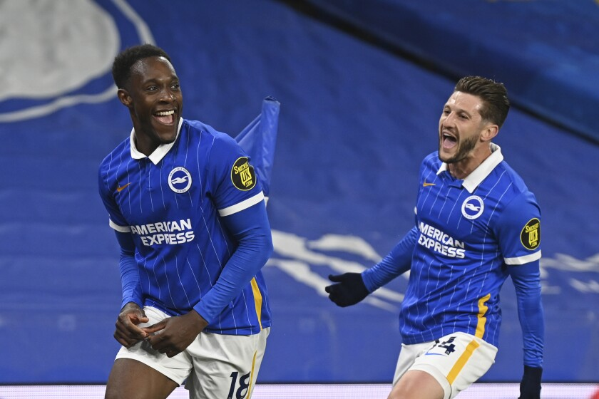 Brighton's Danny Welbeck, left, celebrates with Adam Lallana after scoring his side's opening goal during an English Premier League soccer match between Brighton & Hove Albion and West Ham United at the Amex stadium in Brighton, England, Saturday May 15, 2021. (Neil Hall, Pool via AP)