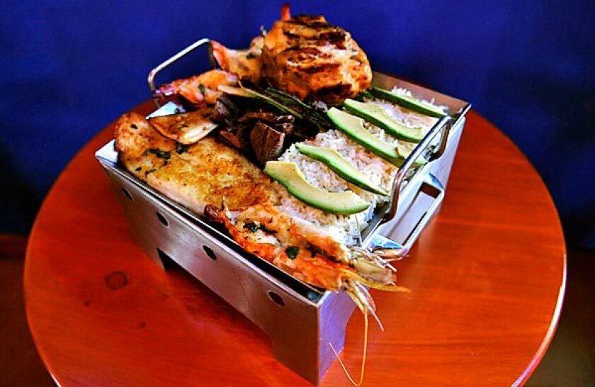 Carne asada, shrimp and chicken all play roles in Sonsonate Grill's parrillada Salvadoreña.