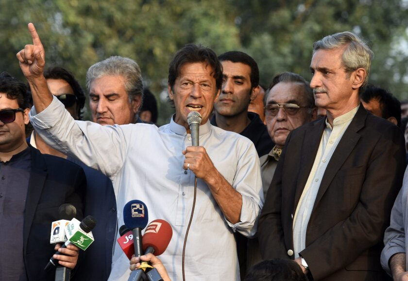 Imran Khan, the head of opposition political party Pakistan Tehrik-e-Insaf, is flanked by his party leaders during a press conference in Islamabad, Pakistan, on Oct. 31, 2016.