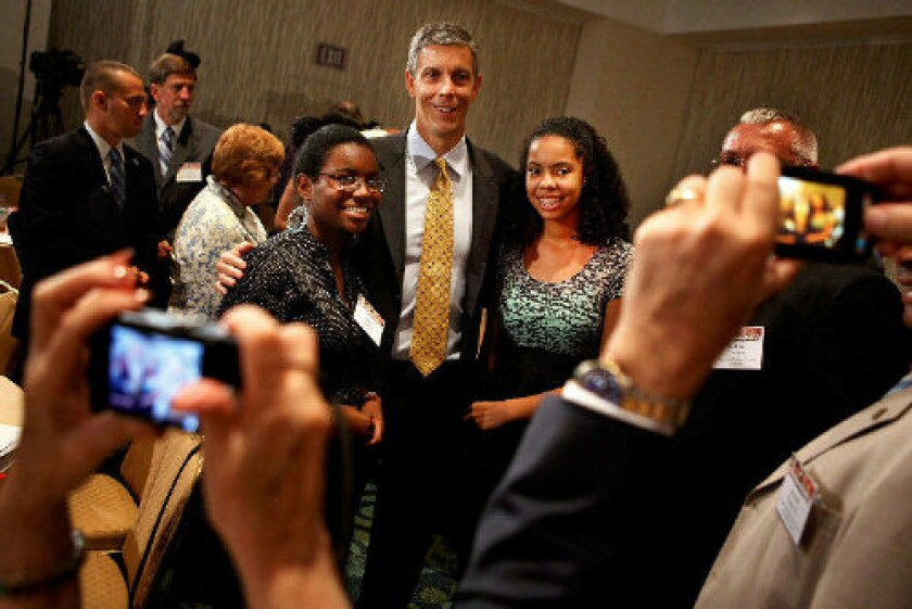 U.S. Education Secretary Arne Duncan, with students at a summit in Washington last week, favors the use of value-added analysis and the public release of data on teachers' effectiveness.