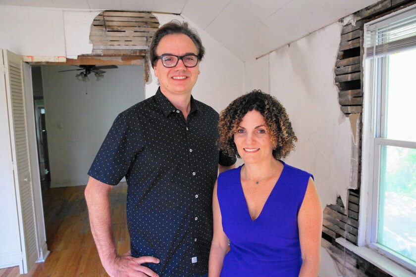 Brent Young and Dina Benadon inside Walt Disney's birthplace in a working-class Chicago neighborhood. The owners aim to open a multimedia museum showing what life was like for the Disneys in the early 20th century.