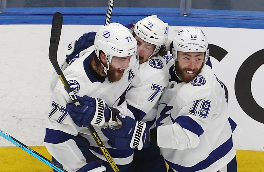Tampa Bay Lightning forward Anthony Cirelli celebrates with Victor Hedman and Barclay Goodrow.