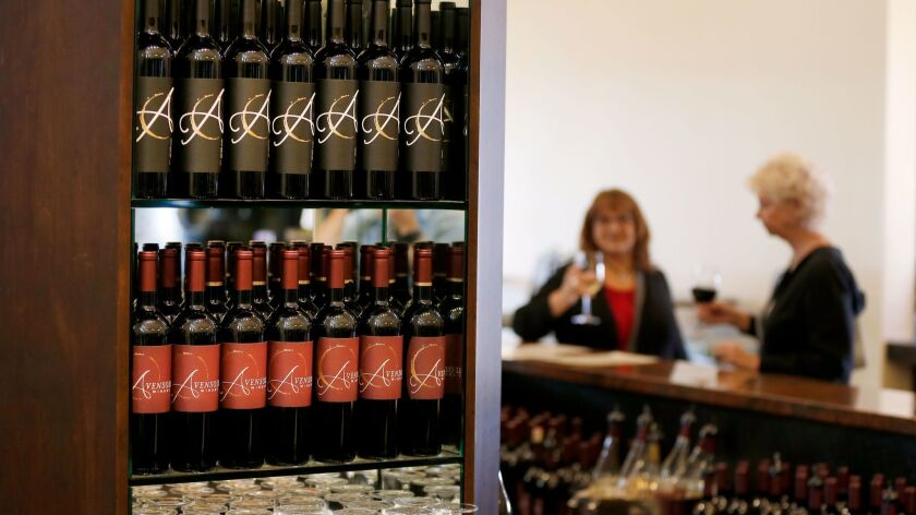 Wines on display with customers at Avensole Vineyard & Winery in Temecula. The fires in Napa and Sonoma counties in October may bring new attention and business to the Temecula Valley wine region, industry experts say.