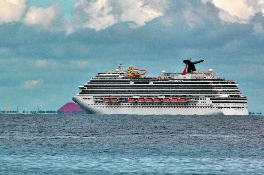 Mexican authorities Friday blocked a Carnival cruise ship from docking in Cozumel after the U.S. CDC alerted Carnival Corp. that a passenger may have handled Ebola-contaminated lab specimens.