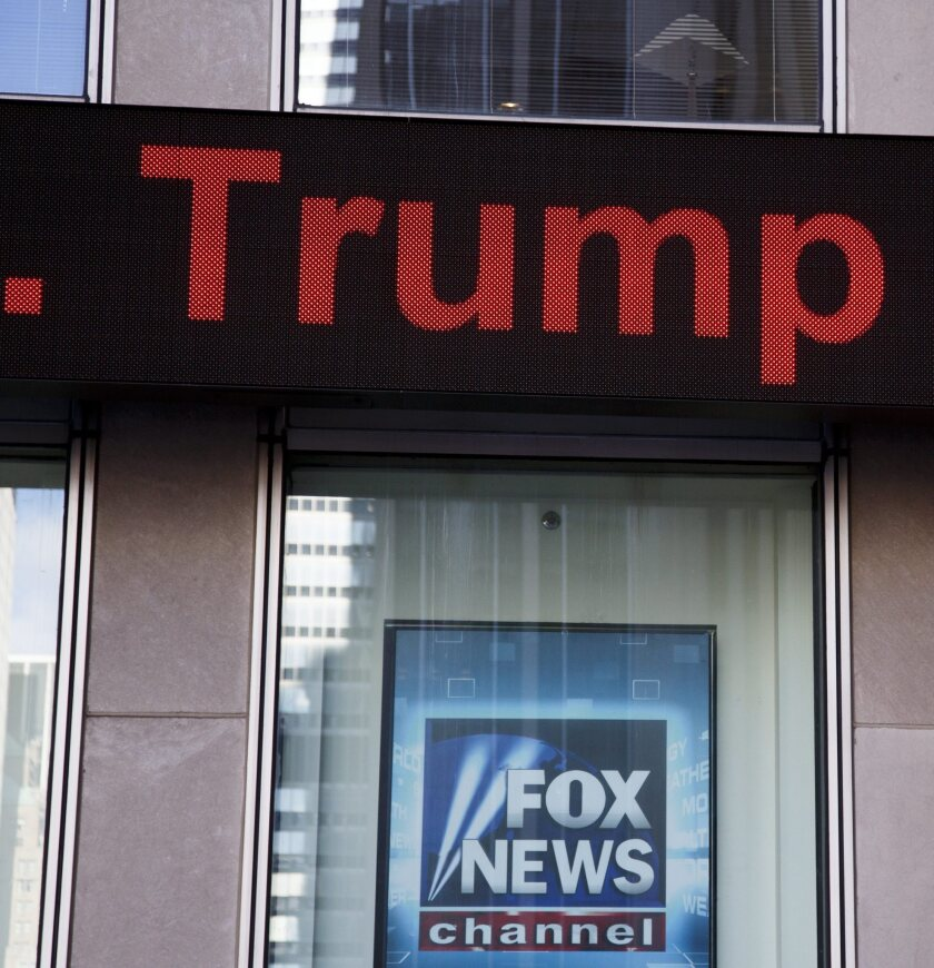 President-elect Donald Trump's name passes on a news ticker over a sign on the Fox News studios in New York on Nov. 22.