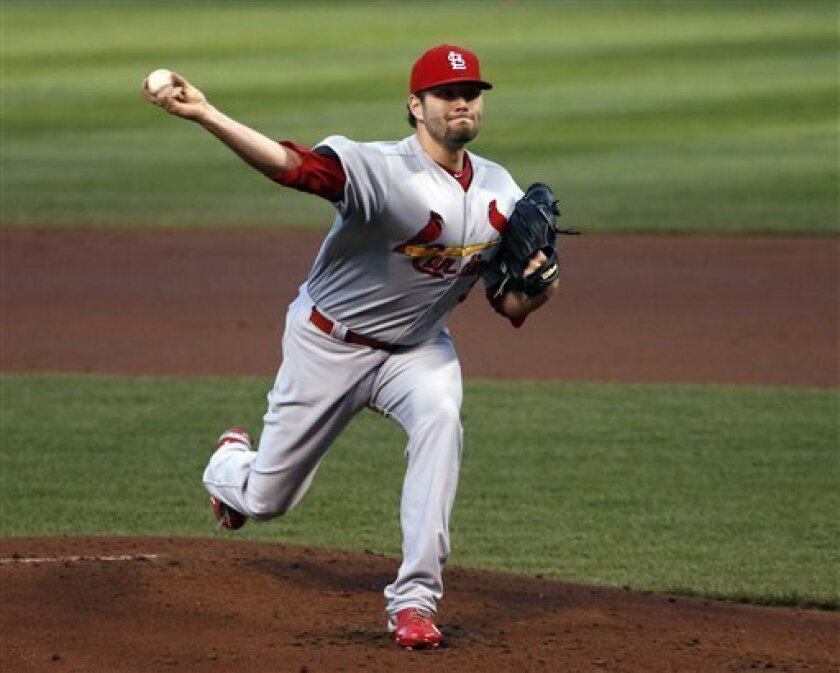 St. Louis Cardinals starting pitcher Lance Lynn delivers during the first inning of a baseball game against the Chicago Cubs, Tuesday, May 7, 2013, in Chicago. (AP Photo/Charles Rex Arbogast)