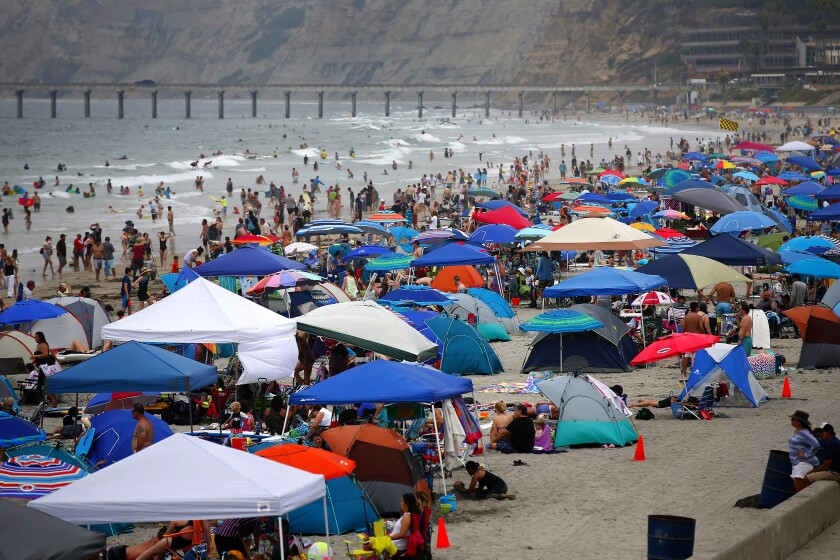 There was no sign of exodus on Labor Day weekend in 2019 when thousands of beach-goers lined the coast at La Jolla Shores.