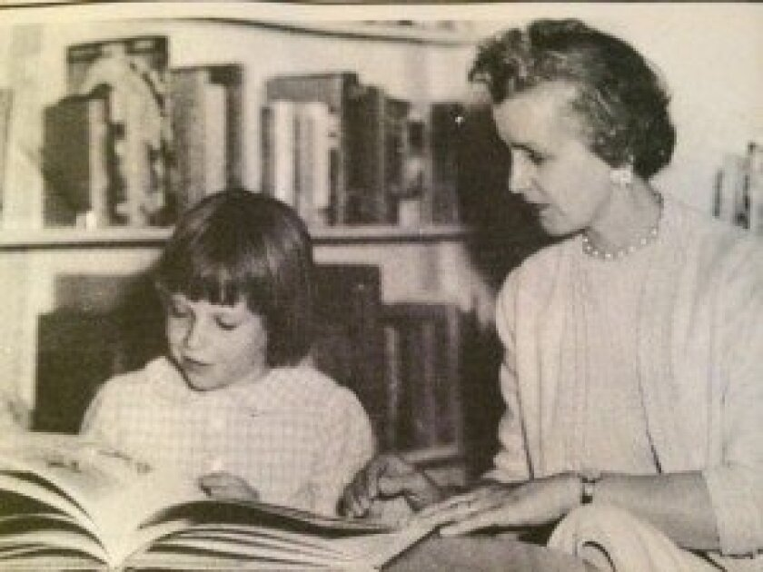 A woman reads with a child in the Rancho Santa Fe Library in 1964.
