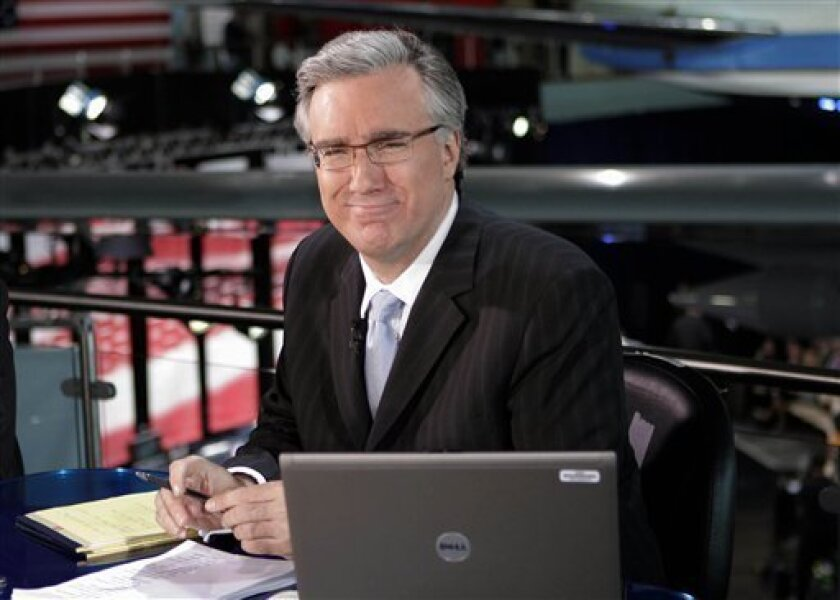 FILE - In this May 3, 2012 file photo, Keith Olbermann poses at the Ronald Reagan Library in Simi Valley, Calif. Olbermann and Current TV say they've settled their dispute nearly a year after Olbermann was fired by the network and responded with a $50 million lawsuit. Both parties say in a Wednesday, March 13, 2013 statement that the terms of the settlement are confidential. Olbermann was fired last March as a host and executive at the left-leaning cable talk network. (AP Photo/Mark J. Terril