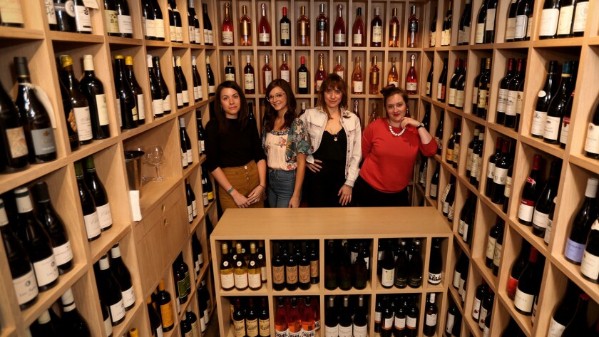 Helen Johannesen, third from left, in her wine shop, Helen's Wines, which sits in the middle of Jon