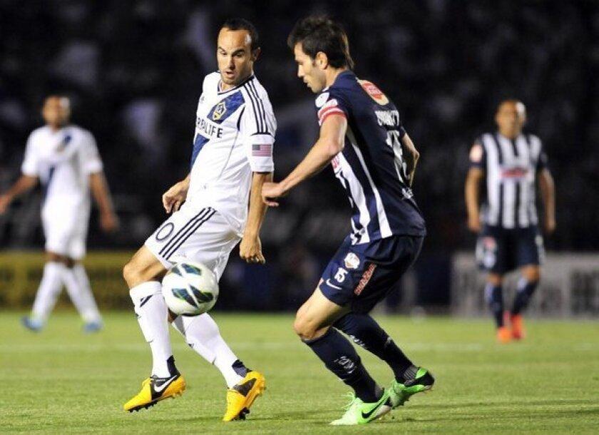 Landon Donovan, left, vies for the ball with Monterrey's Jose Basanta during a Champions League game.