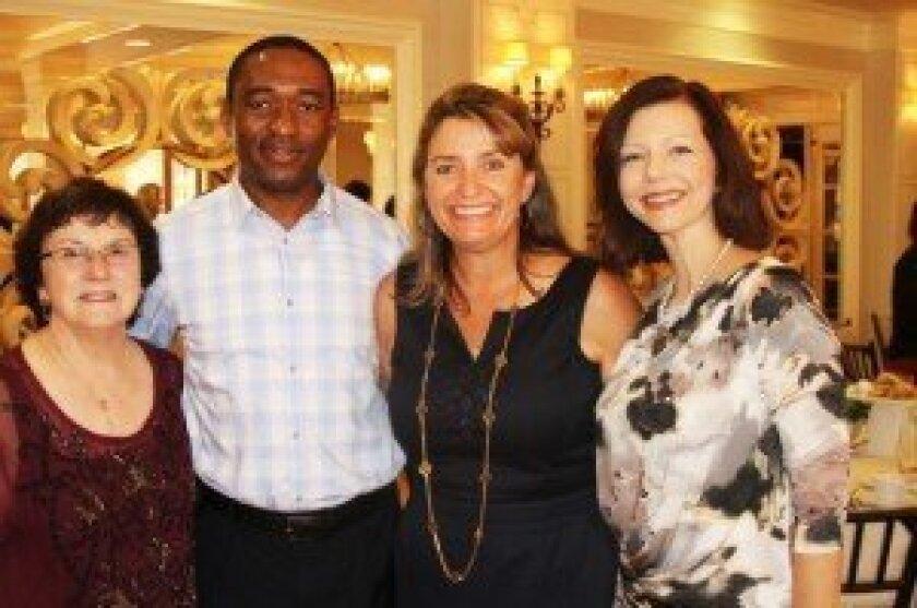 Jean Colarusso, Father Lawrence, Marcella Johnson and Allison Quattrocchi.
