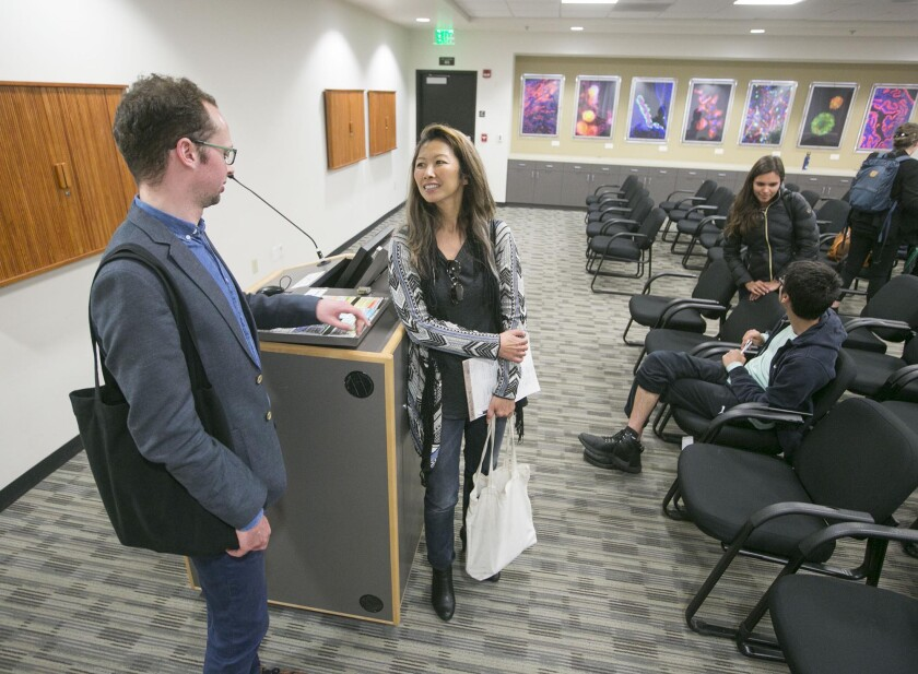 Grace Cheng, right, Director of the Interdisciplinary Human Rights Initiative at SDSU spoke with Armin Langer, German activist, author and coordinator of the group Salaam-Shalom after he delivered a standing room only crowd at the Gold Auditorium at San Diego State on Tuesday, April 30, 2019.