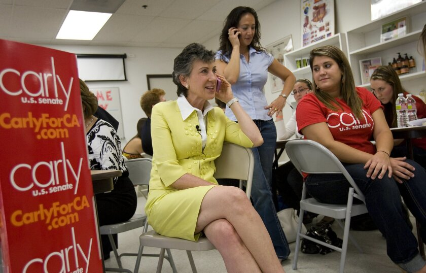 GOP Senate candidate Carly Fiorina makes a stop in San Diego to take calls alongside volunteers working at her campaign phone bank in Sorrento Mesa. With the former Hewlett-Packard CEO on Friday were Rebecca Risty (center) and Lizzy Blumberg.