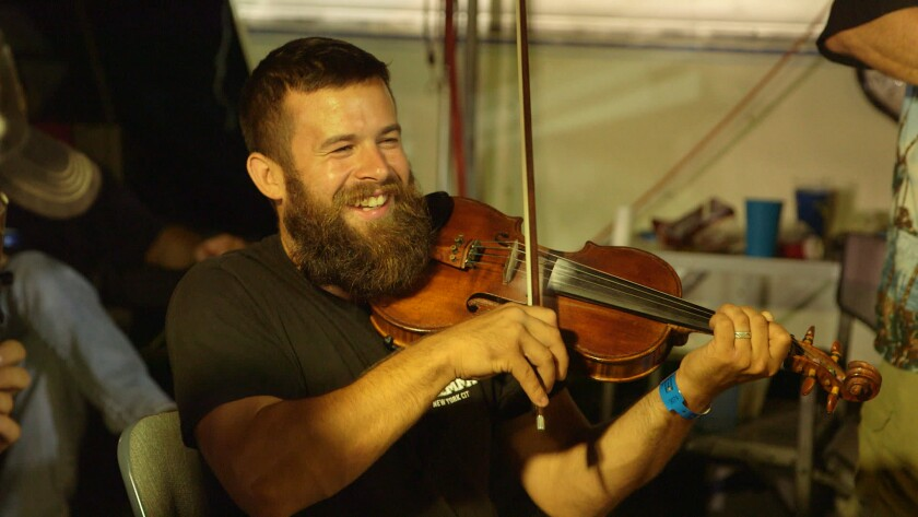 Jake Krack plays the fiddle in the documentary 'Fiddlin'