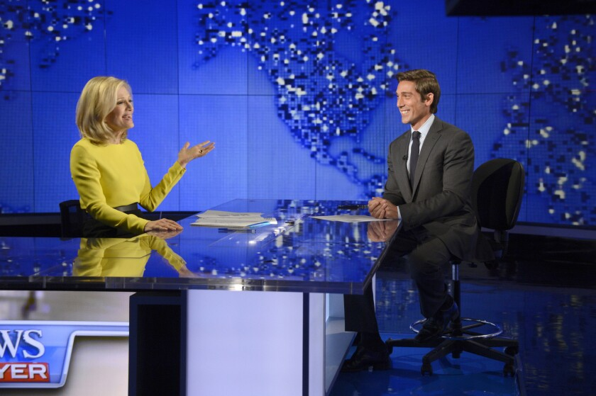 David Muir and predecessor Diane Sawyer at ABC