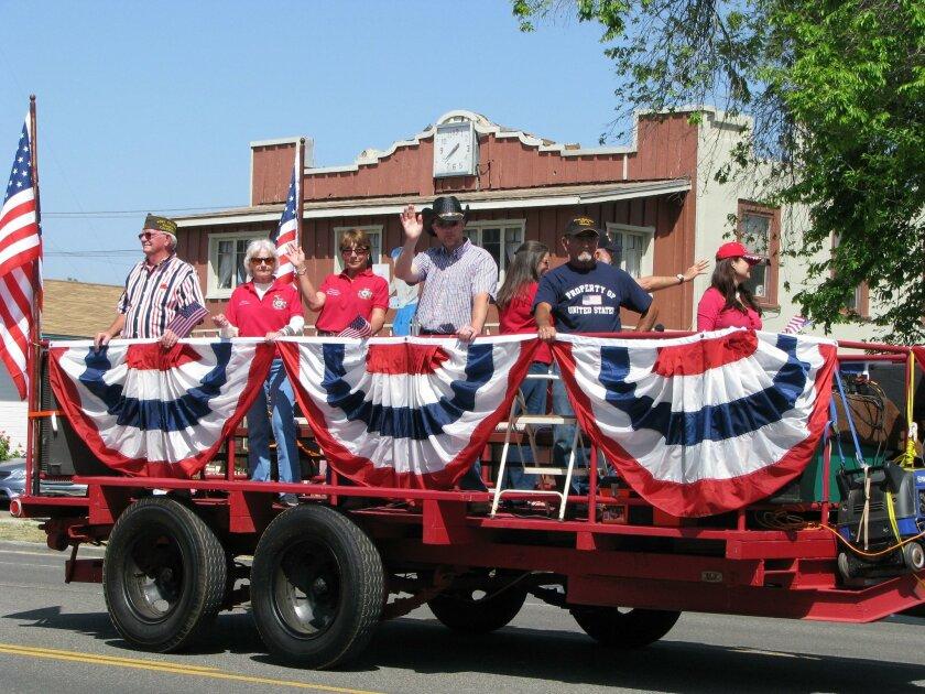 A float parades down Main Street.