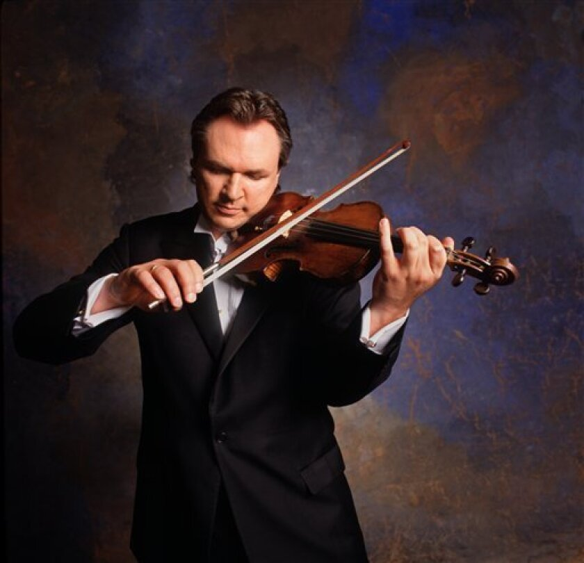 In this studio portrait released by OMAC Records, fiddler Mark O'Connor is shown. (AP Photo/OMAC Records, Jim McGuire)