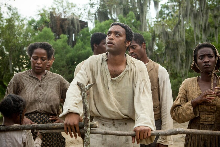 """Chiwetel Ejiofor, center, in a scene from """"12 Years A Slave."""" (AP Photo/Fox Searchlight, Jaap Buitendijk)"""