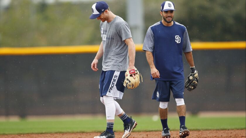 Cory Spangenberg, left, and Carlos Asuaje take infield early in spring training.
