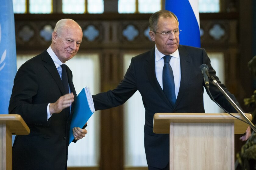 Russian Foreign Minister Sergey Lavrov, right, and U.N. Special Envoy for Syria Staffan de Mistura leave a news conference following their talks in Moscow, Russia, Wednesday, Nov. 4, 2015. Lavrov says he hopes that international peacebrokers in the coming days will agree on the list of opposition g