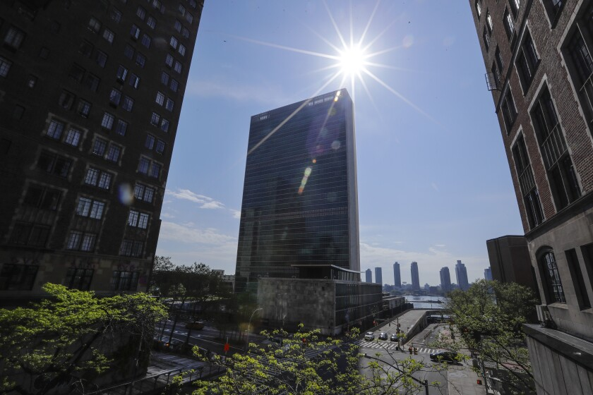 Sparse traffic because of the coronavirus moves past United Nations headquarters in New York in May.