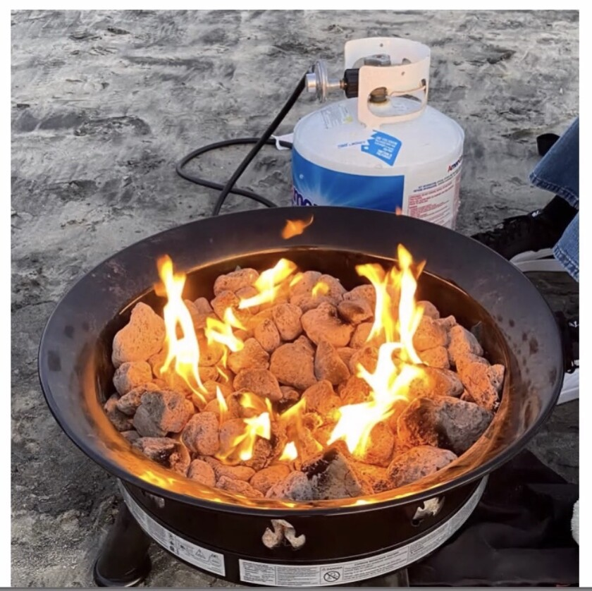 Meinrat Andreae, an atmospheric chemist, suggests switching to propane fires like this on local beaches.