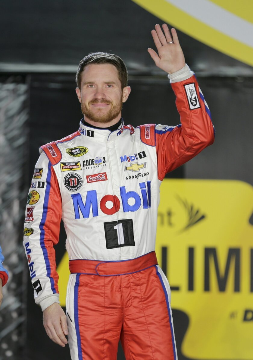 Brian Vickers waves to fans during driver introductions for the Sprint Unlimited auto race at Daytona International Speedway, Saturday, Feb. 13, 2016, in Daytona Beach, Fla. (AP Photo/Terry Renna)