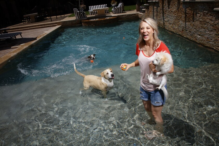 Actress Kaley Cuoco, pictured in the swimming pool at her Tarzana home, has sold the three-quarter-acre estate for $3.95 million.